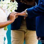 Bride and groom exchange rings in outdoor surprise ceremony
